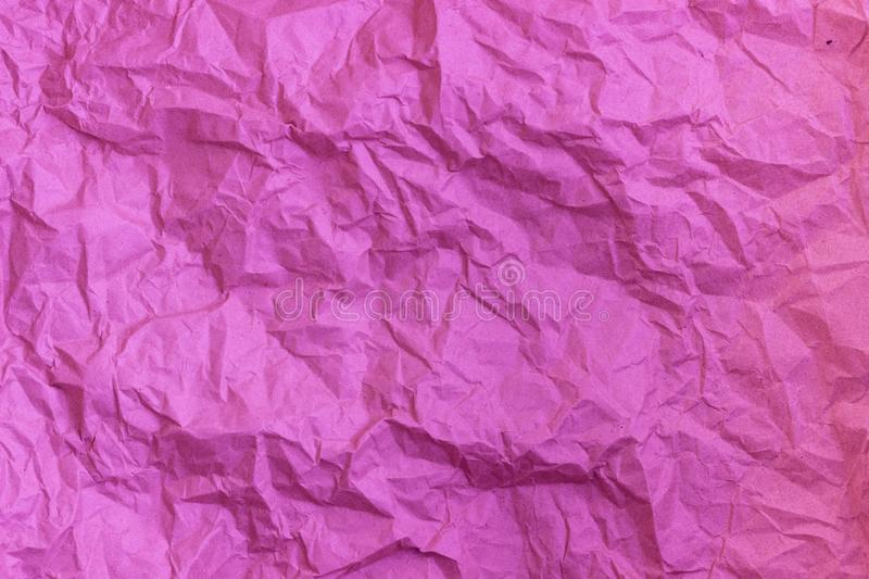 Purple wrinkle recycle paper background. Texture of crumpled paper. Texture of rumpled old paper close-up stock images