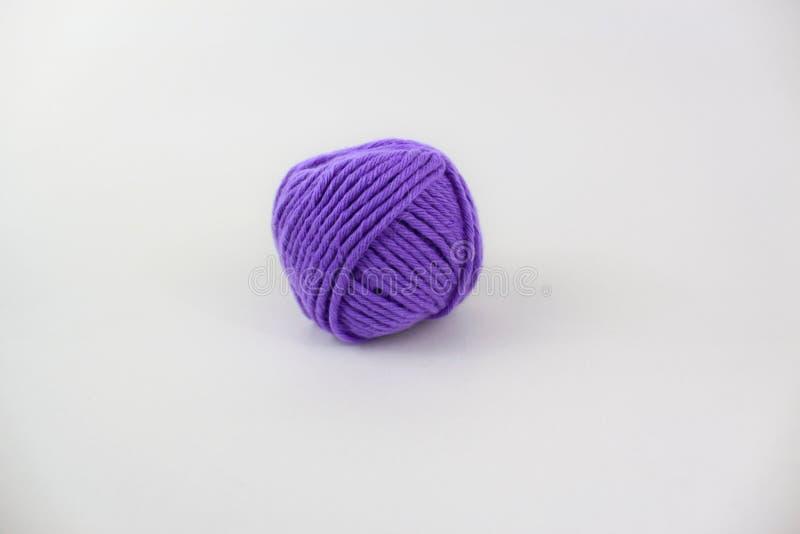 Purple yarn isolated on white background stock photo