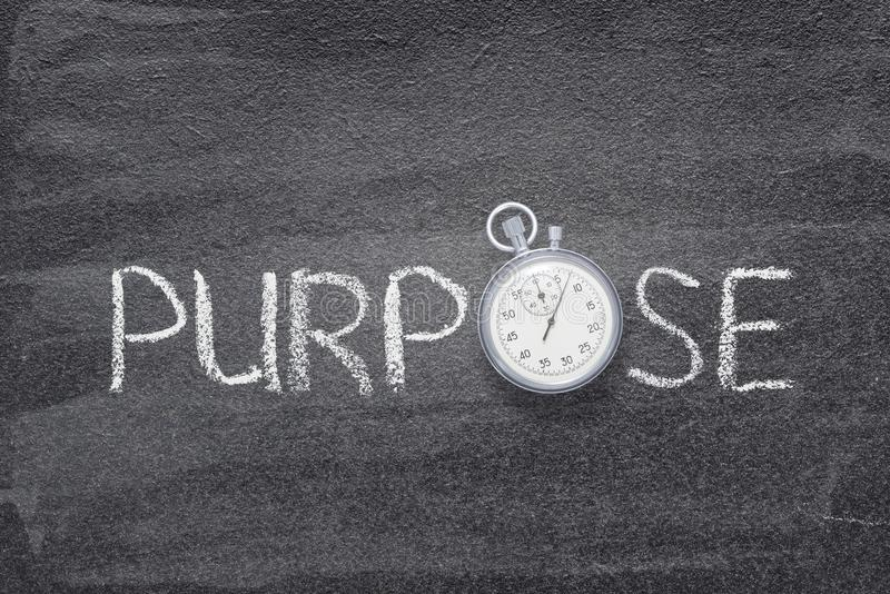 Purpose word watch. Purpose word handwritten on chalkboard with vintage precise stopwatch used instead of O stock photography