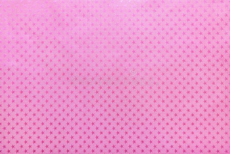 Purpurfärgad bakgrund från papper för metallfolie med en stjärnamodell royaltyfria foton