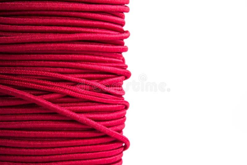 Purpurfärgad elastisk kabel arkivbild