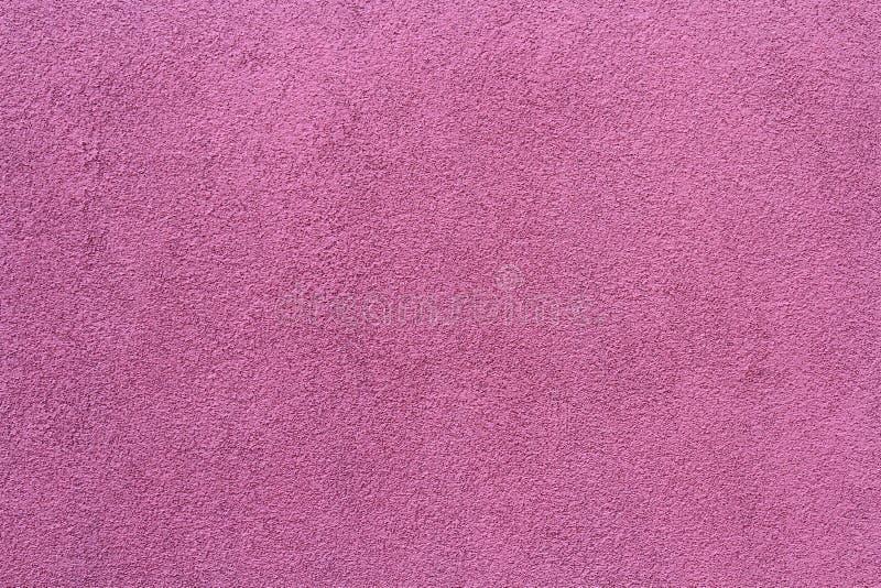 Purpurfärgad rosa bakgrund med textur fotografering för bildbyråer