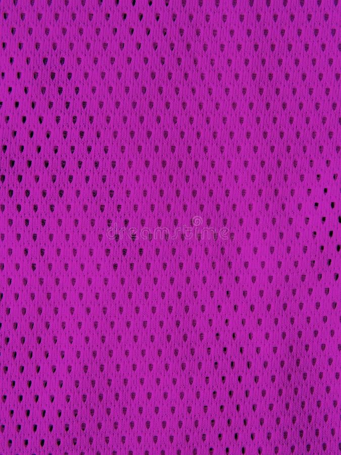 Purpurfärgad sportärmlös tröja arkivfoton