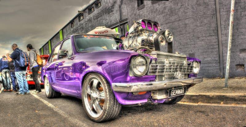 Purpurfärgade Holden Tvillingarna arkivbild
