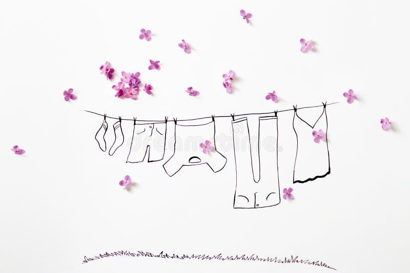 Purpurfärgade lila blommor med teckningen av en kläderlinje med tvätterit vektor illustrationer