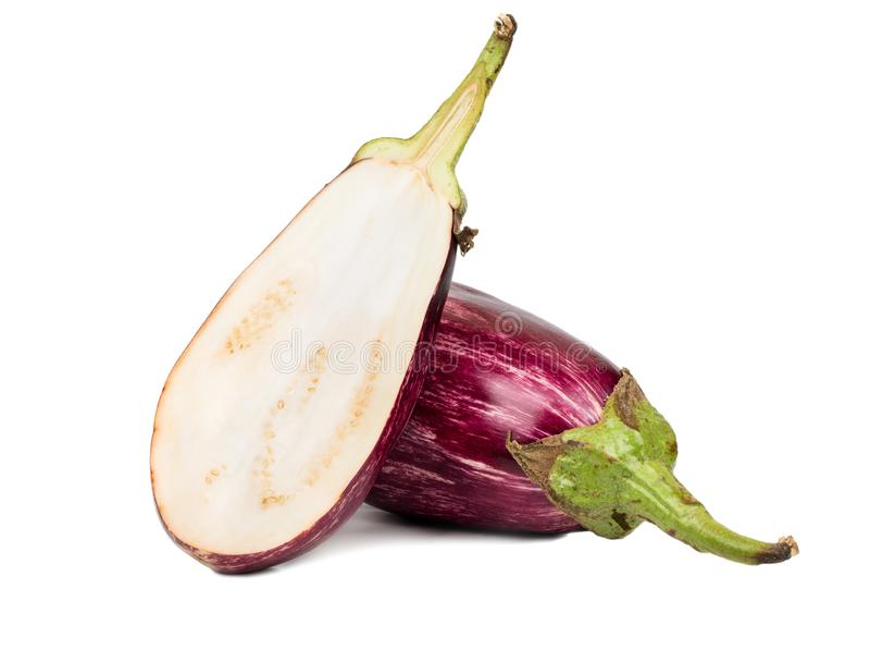 Purpurowa oberżyna z połówką zdjęcie royalty free