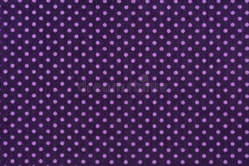 Purpurowa tkanina i Biały Malutki polek kropek tło zdjęcia stock