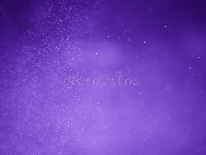 Purpurowego fiołkowego bokeh abstrakcjonistyczny tło i tekstura obraz royalty free