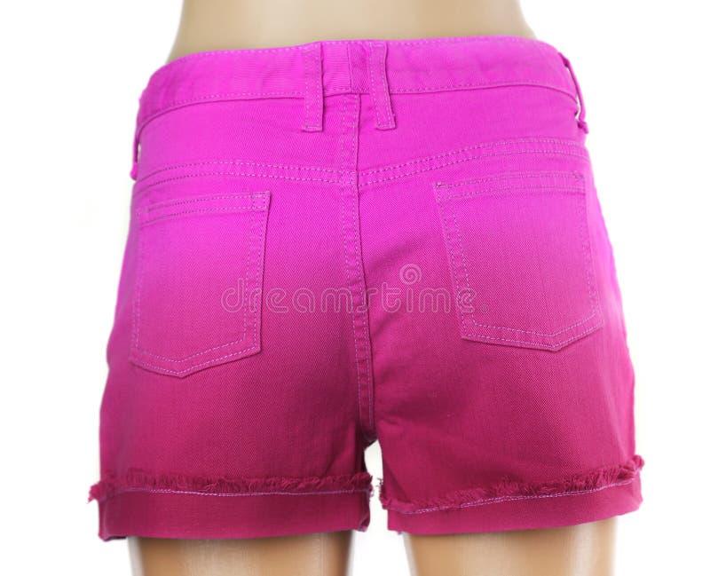 Purpurrote Frauenkurze jeanshose. lizenzfreie stockfotografie