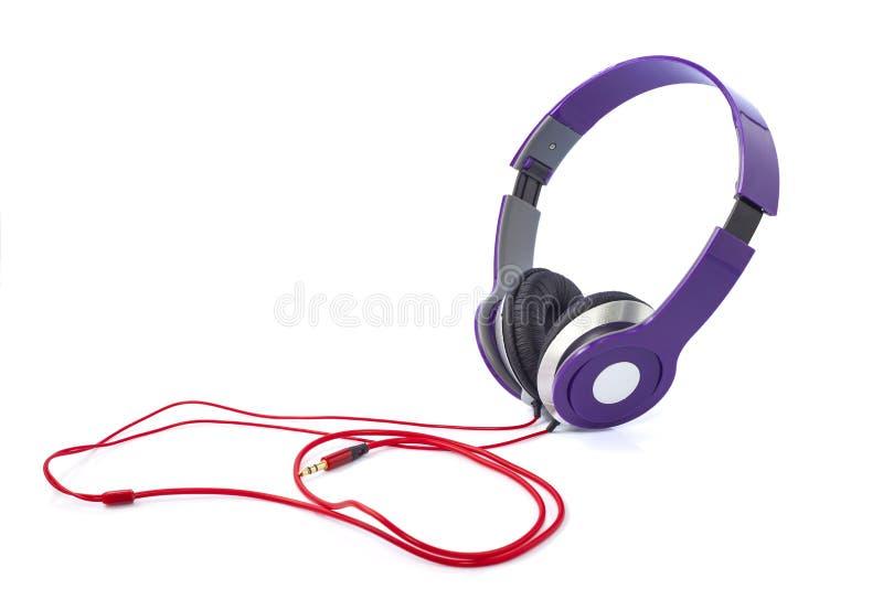 Purpurrote Kopfhörer lizenzfreie stockbilder