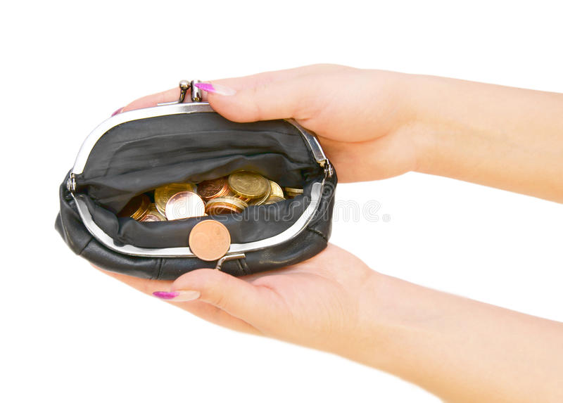 Purse with coins in a hand. On a white background royalty free stock photography