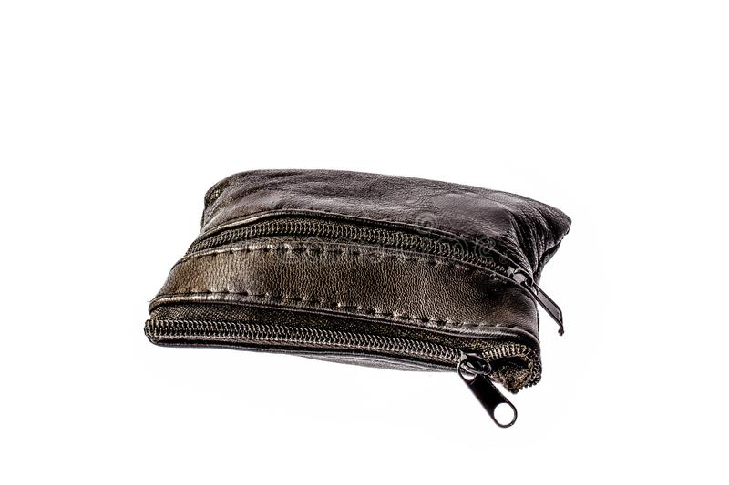 A purse full of coins and closed on zipper royalty free stock images