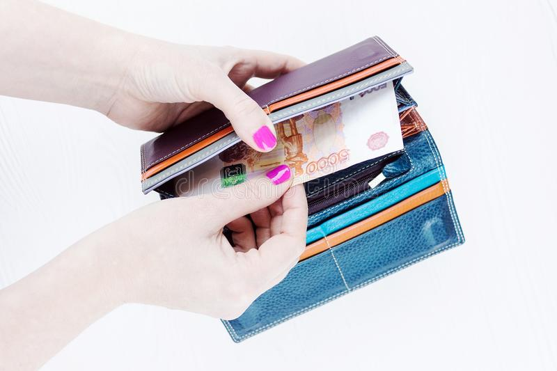 Purse with money in hands stock photography