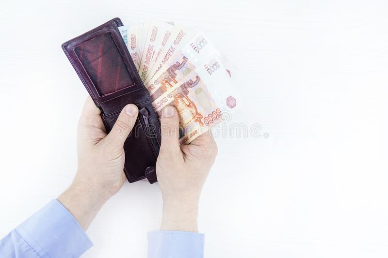 Purse with money in hands royalty free stock image