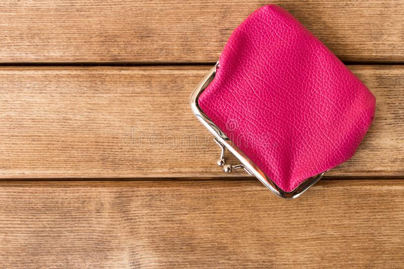 Purse on a wooden table . On wooden background royalty free stock images