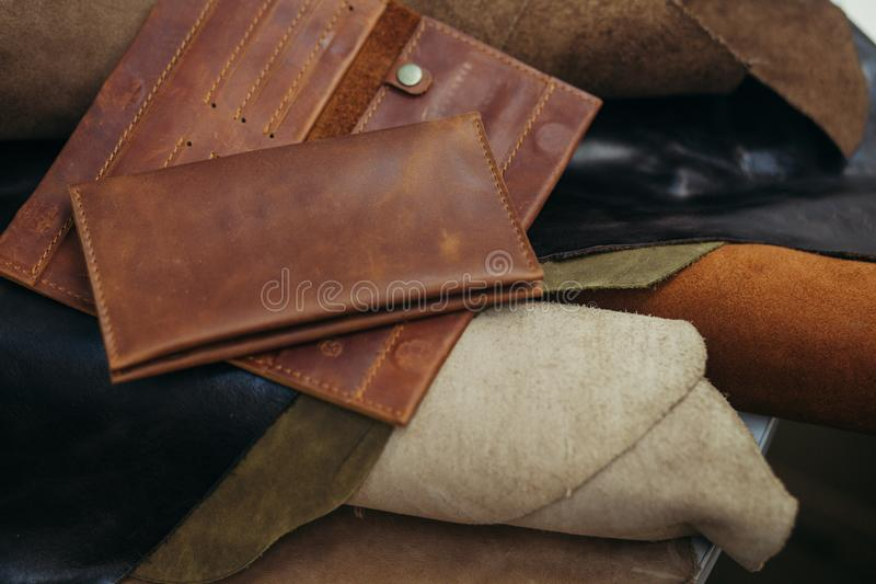 Purses in different styles which made from colorful genuine leather.  royalty free stock photography