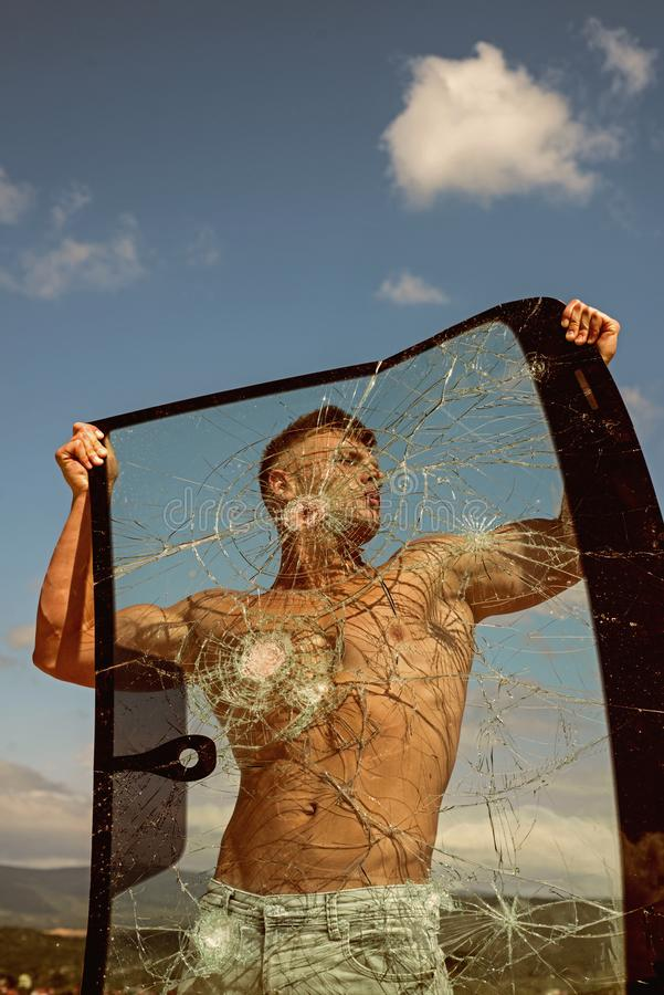 Pursuing his ambition. Strong man hold cracked glass. Sport man with muscular strength. Sport training. Achieving sport. Ambition with right workout. Focus on stock photos