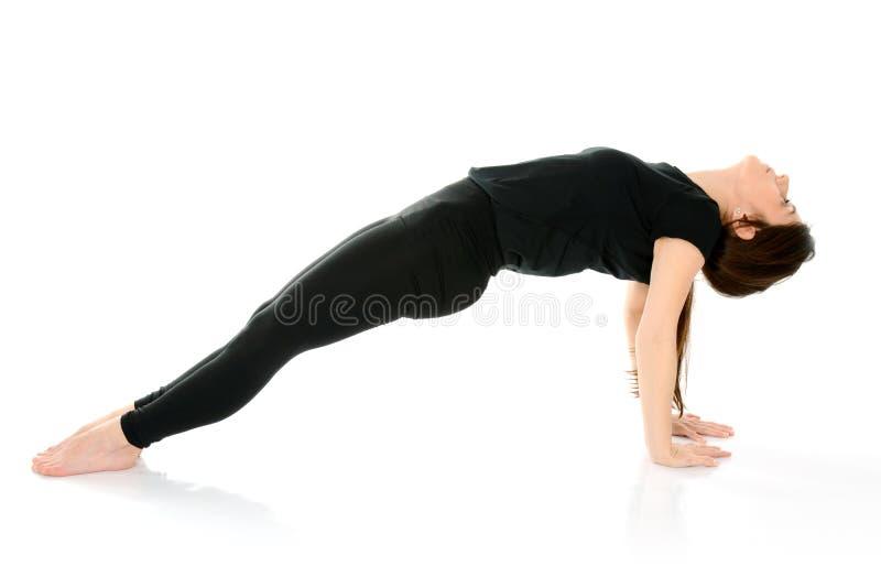Purvottanasana upward plank pose yoga, Purvottansana as a Chaturanga Counterpose. Young woman doing yoga asana Purvottanasana upward plank pose yoga isolated on stock photo