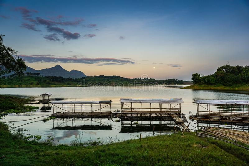 Purwakarta, West Java, Indonesia (03/30/2018) : Beautiful sunrise in Jatiluhur Dam fishing place. Nature, water, sky, view, landscape, travel royalty free stock photography