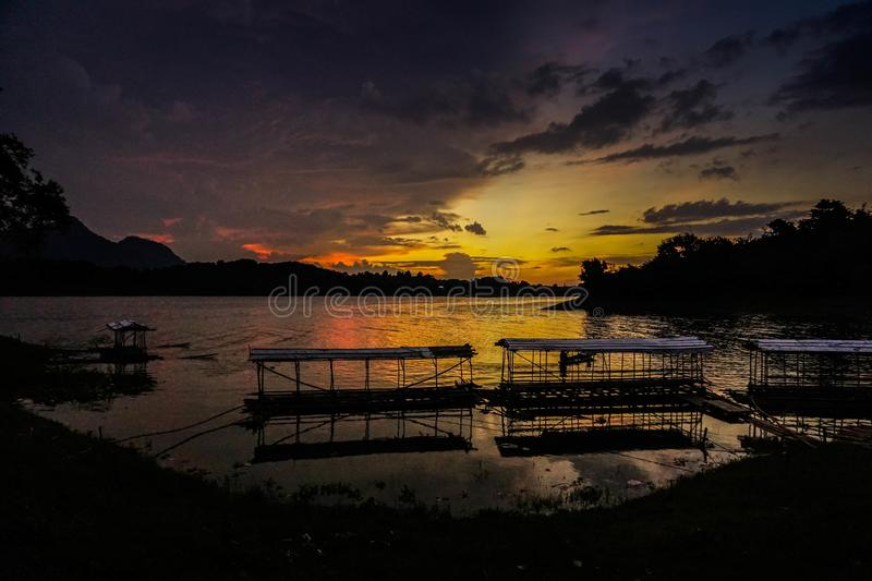 Purwakarta, West Java, Indonesia (03/30/2018) : Beautiful sunset in Jatiluhur Dam fishing place. Nature, water, sky, view, landscape, travel, outdoor royalty free stock images