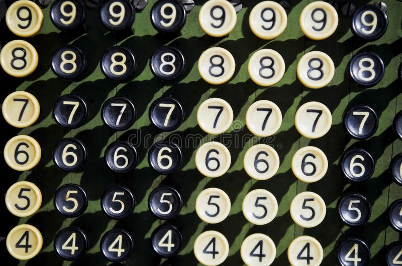 Push button retro calculator. Push button umbers 987654 overview of a vintage adding machine. count touch push calculate numbers binary retro Drucktabulator royalty free stock photography