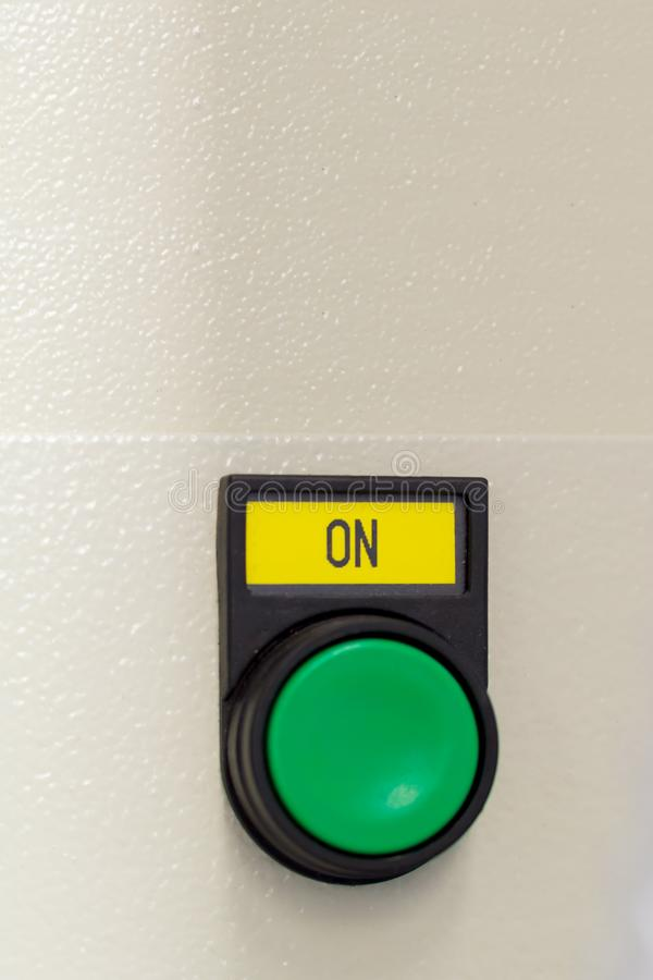 push green button on on device stock photography