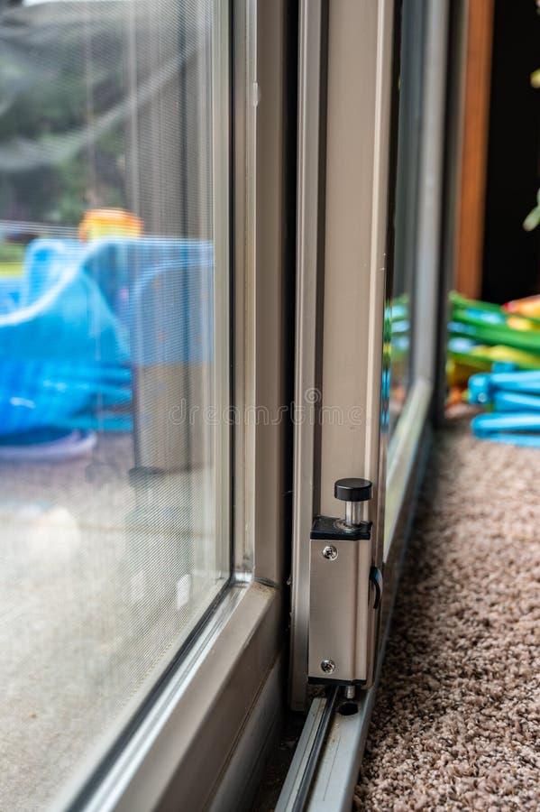 Free Push Locking Mechanism For Sliding Glass Door Hardware Security Stock Photo - 188670350