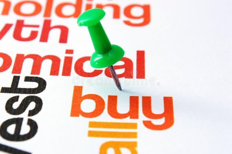 Push pin on buy text.  stock photos