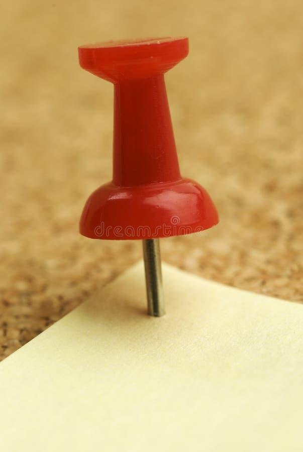 Push-pin on Cork-board. Closeup image of pushpin on cork-board royalty free stock photography