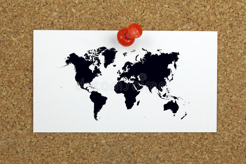 Push pin holding card with world map on a cork board stock image download push pin holding card with world map on a cork board stock image image gumiabroncs Gallery