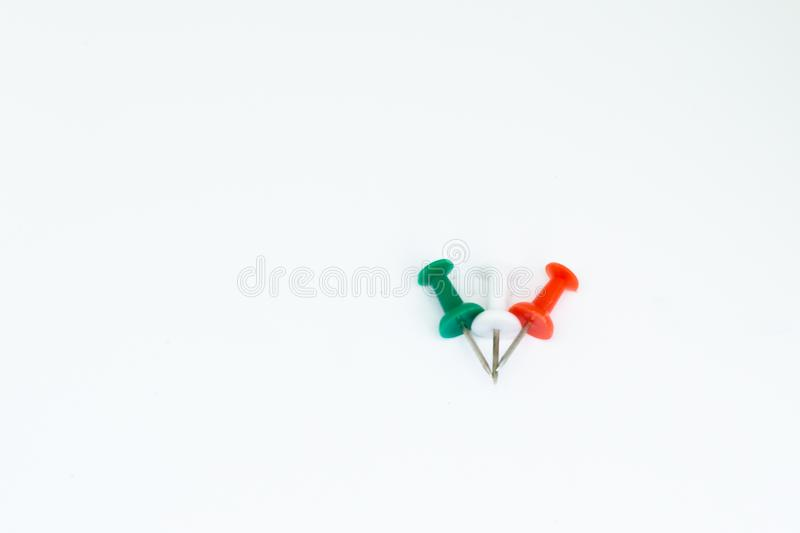 Push pin on the isolated white background stock photo