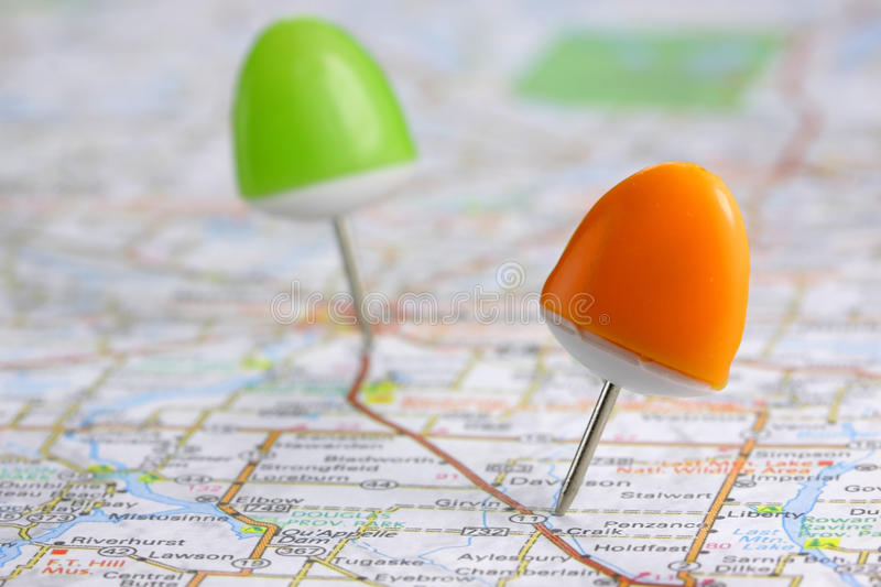 Push pins. Orange and green push pins on the map royalty free stock image