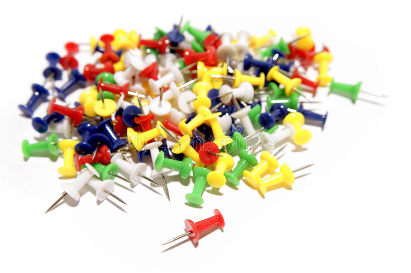 Push-pins. Colorful push-pins over white background royalty free stock photography