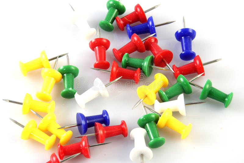 Push pins on white. Various color push pins on white background stock photography