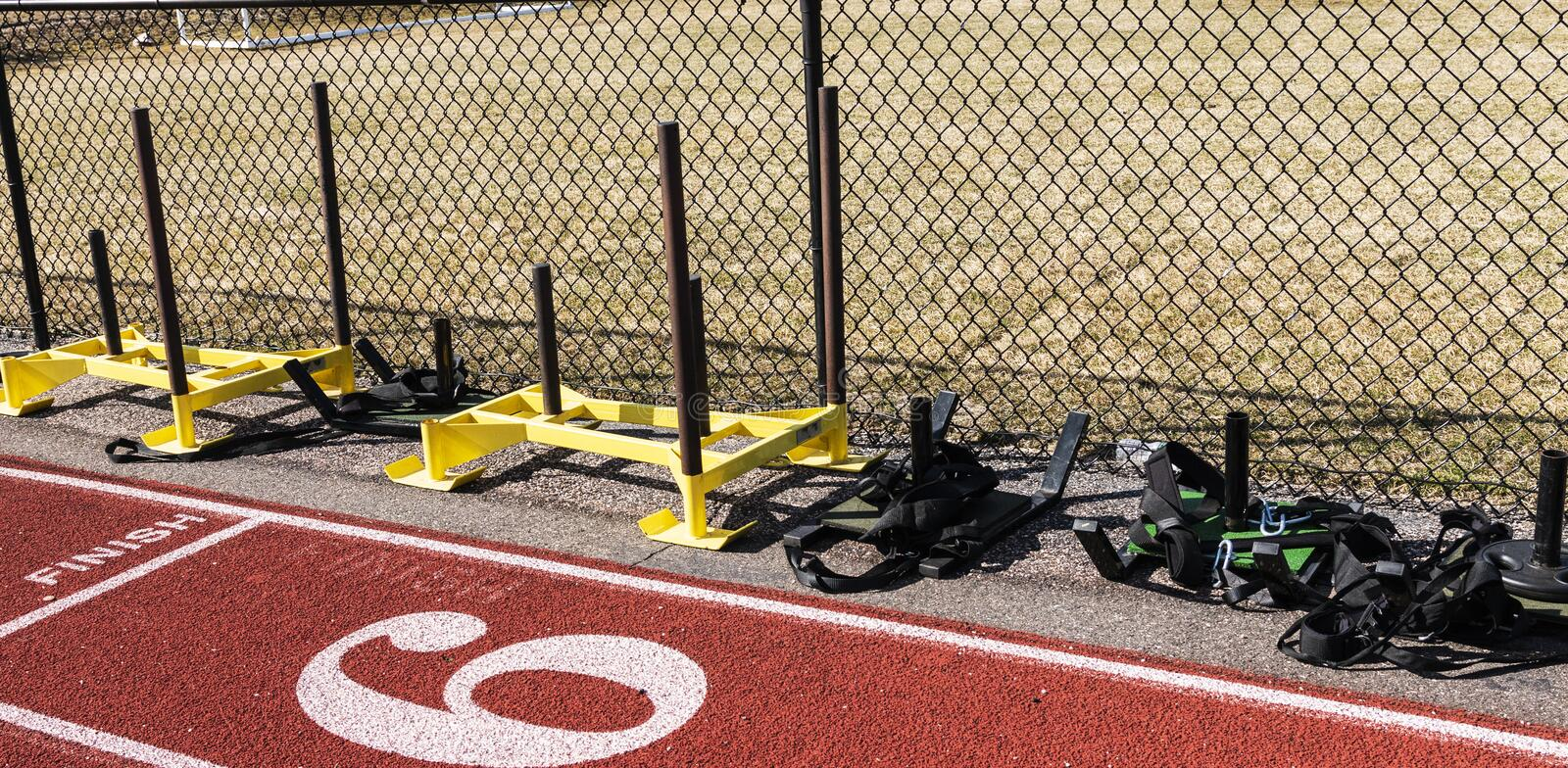Push and pull weight sleds on the side of a track stock images