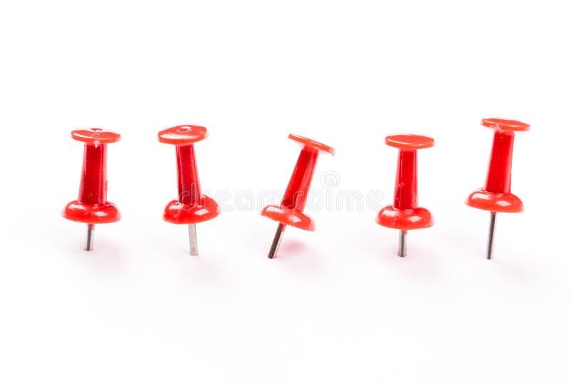 Push red pins isolated on white background. Set of red push pins isolated on white background stock photo