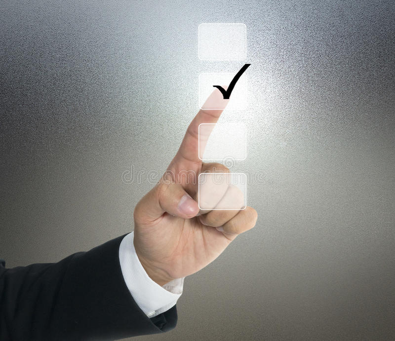 Push tick on lists screen. With hand of business man royalty free stock photos