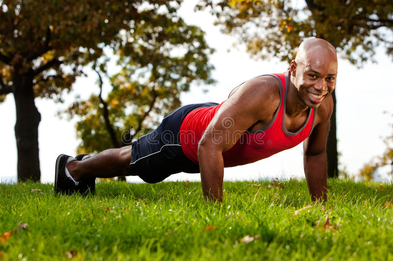 Push Up. A man doing a push up in a park stock photography