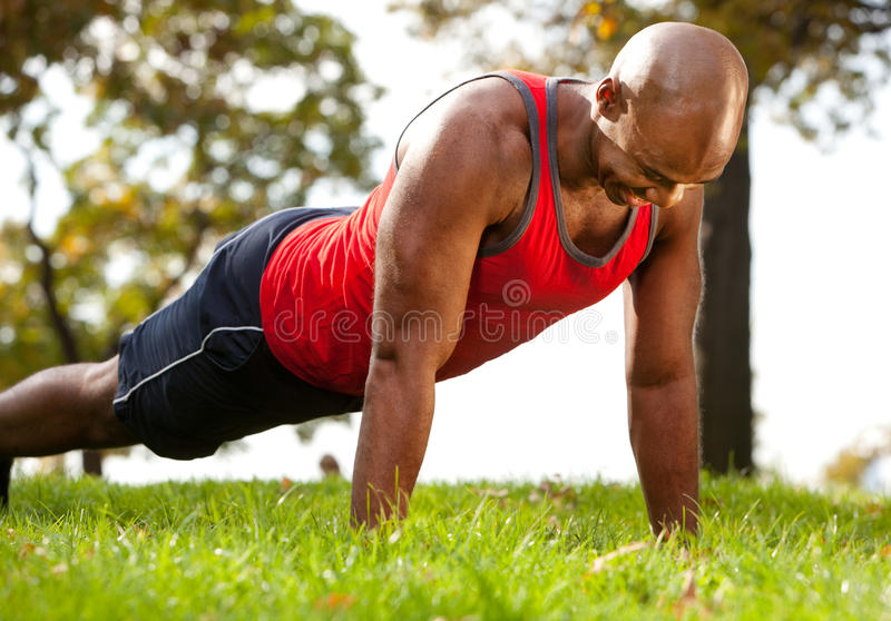 Push Up. A man doing a push up in a park royalty free stock photo