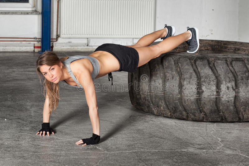 Push up exercise on a tire crossfit training royalty free stock image