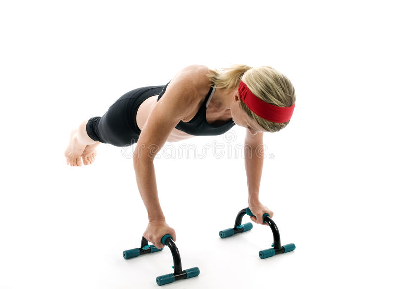 Push up fitness bars woman exercising royalty free stock images
