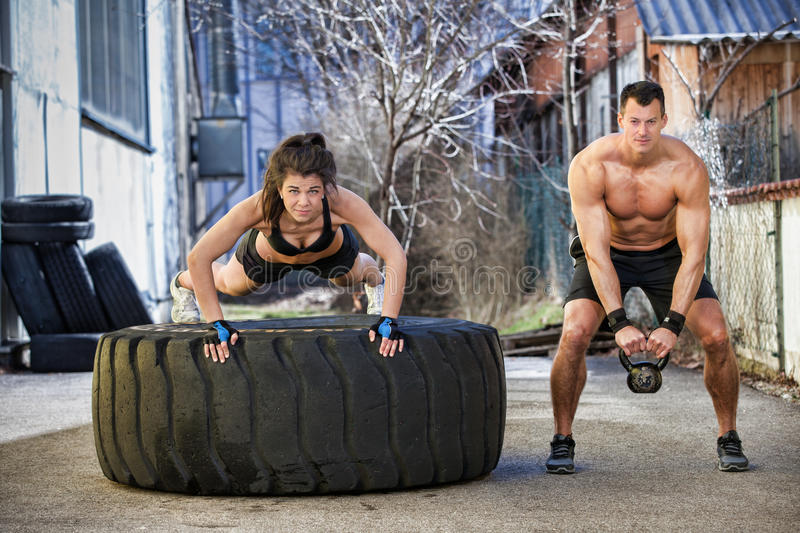 Push up on a tire fitness training royalty free stock images