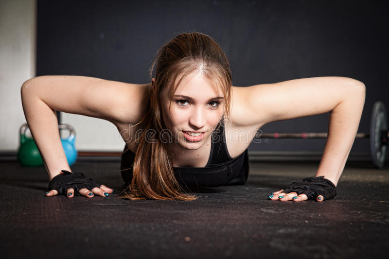 Push up woman doing crossfit fitness training royalty free stock photo