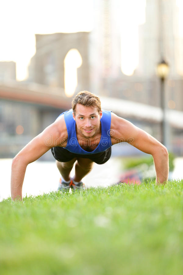 Push-ups - man training in New York City, Brooklyn royalty free stock image