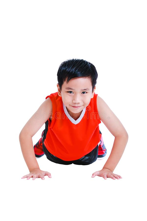 Push-ups or press-ups exercise by asian child. Isolated on white stock images