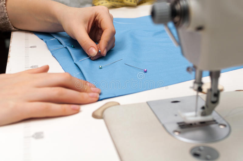 Download Pushes A Pin Into The Fabric Stock Photo - Image: 28771130