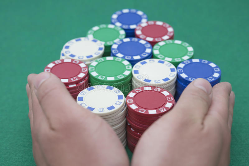 Pushing all the casino chips out for the final round stock photography