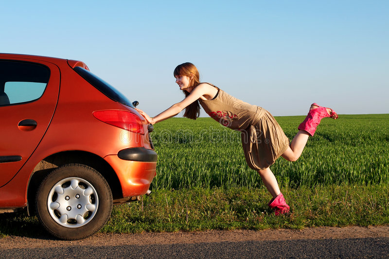 Pushing a car royalty free stock photos