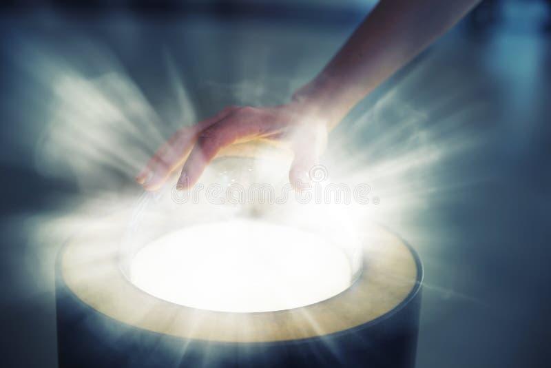 Pushing futuristic glass button. Women hand pushing futuristic glass button royalty free stock photo
