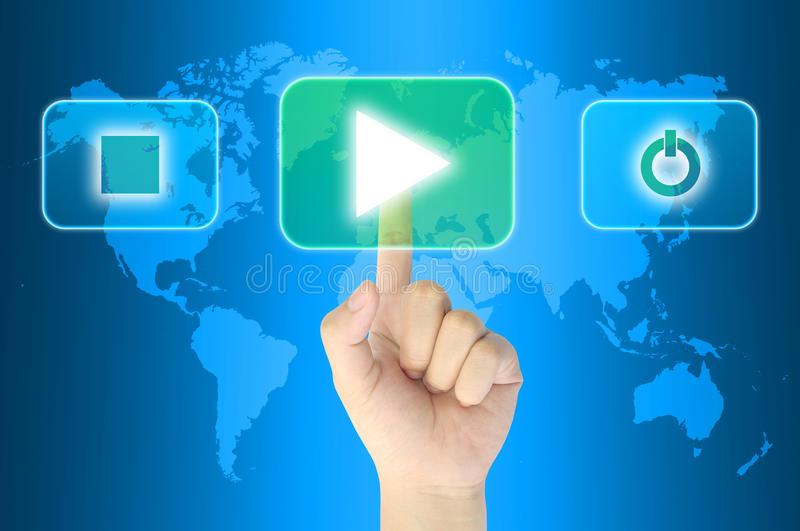 Pushing media player. Hand pushing media player technology button on a touch screen interface stock image